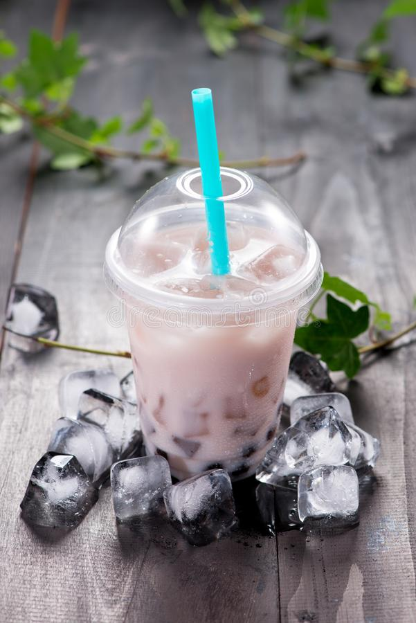 Taro bubble tea and black tapioca pearls on crushed ice.  stock images