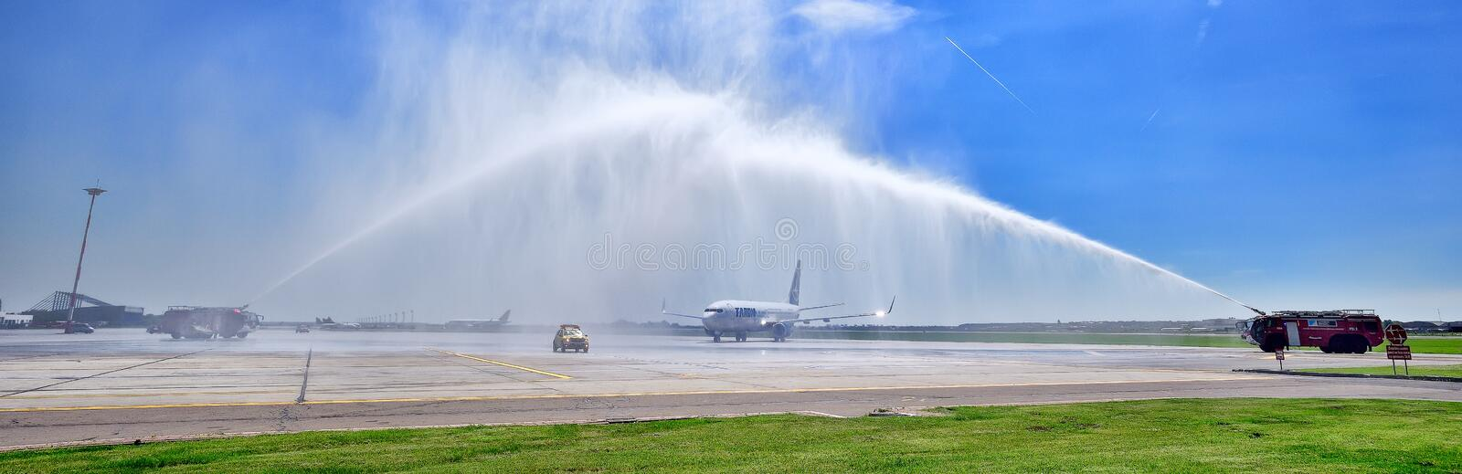 Tarom airplane first landing in Otopeni airport , water jets for inauguration royalty free stock image