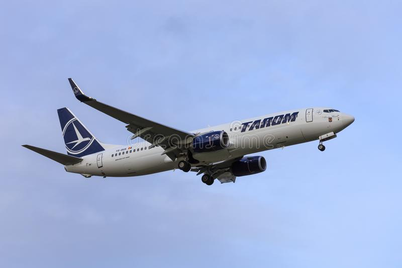 Tarom 737-800. A Tarom Boeing 737-800 is approaching to land royalty free stock image