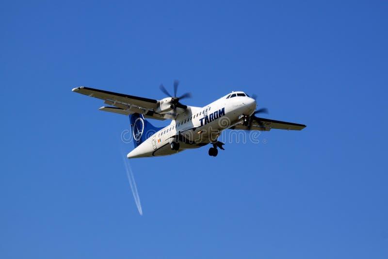 Tarom's ATR 42 landing at Bucharest Otopeni INTL royalty free stock photo