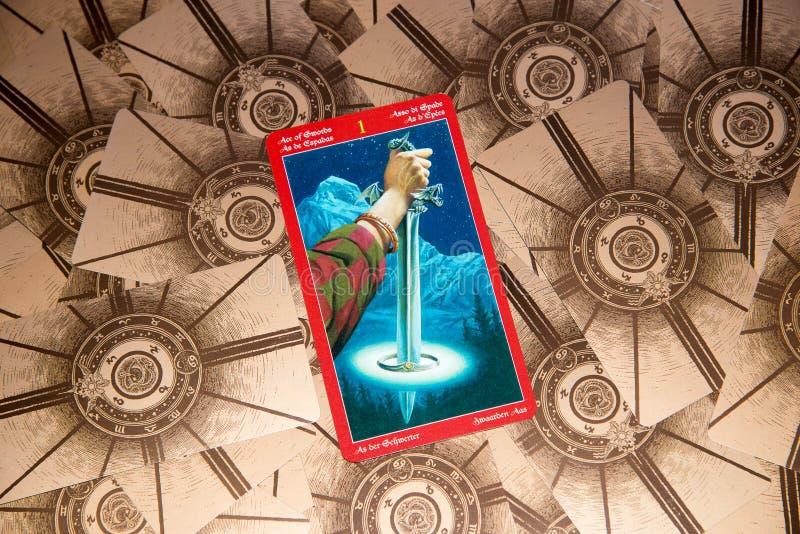 Tarot card Ace of Swords. Dragon tarot deck. Esoteric background. royalty free stock photo