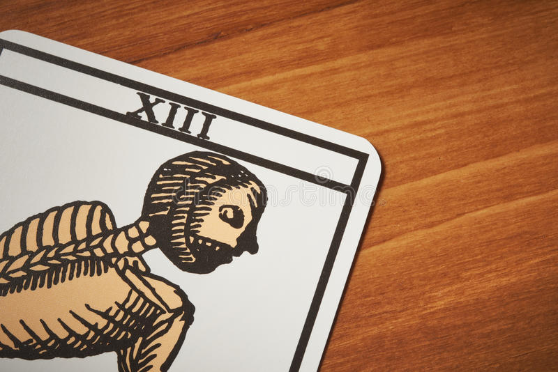 Tarot card death for clairvoyance and divination. On wooden table royalty free stock image