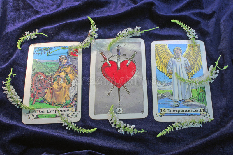 Tarot cards. On violet background stock photos