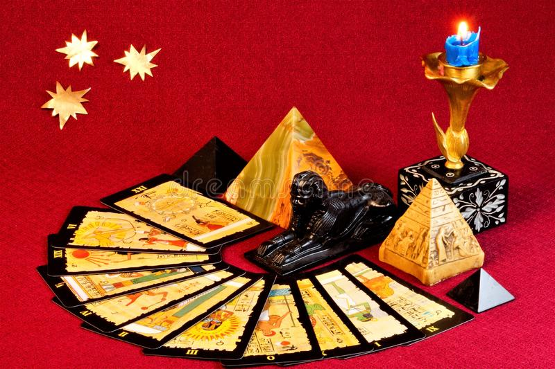 Tarot cards with ancient Egyptian symbols are used for divination, prediction, past, future. Tarot cards are a system of symbols, the images on Tarot cards have stock images