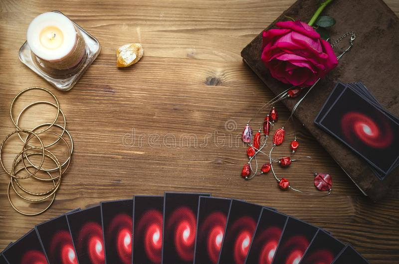 Divination. Tarot cards. Fortune teller. Tarot cards and book of magic on fortune teller desk table background. Love divination concept stock image