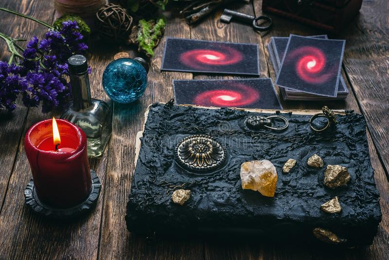 Tarot cards. Tarot cards and book of magic on a wooden table background. Future reading royalty free stock photography