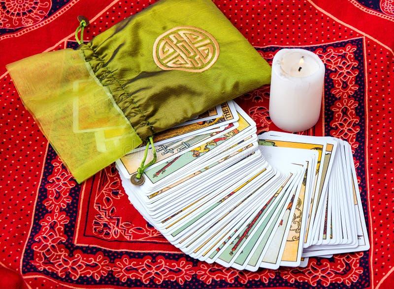 Tarot cards and burning candle stock image