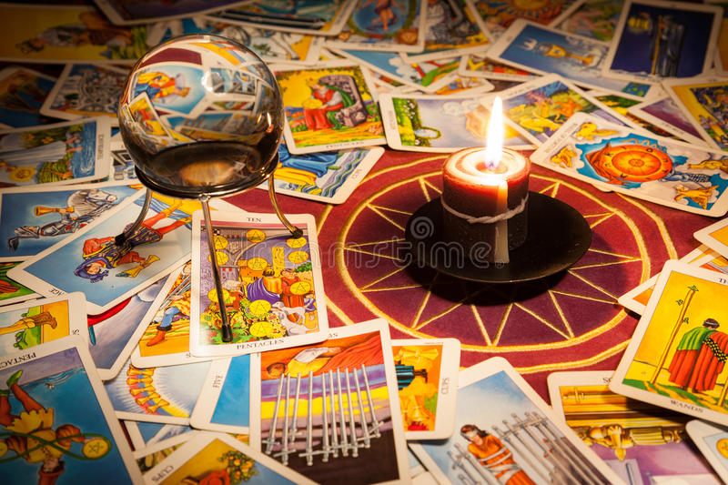 Tarot cards with a candle and crystal ball. stock image