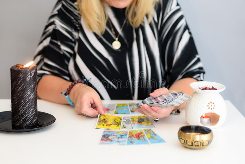 Tarot cards and candles. Card reading. Divination and clairvoyance. Close up woman hands with tarot cards. Card reading. Divination and clairvoyance stock photos