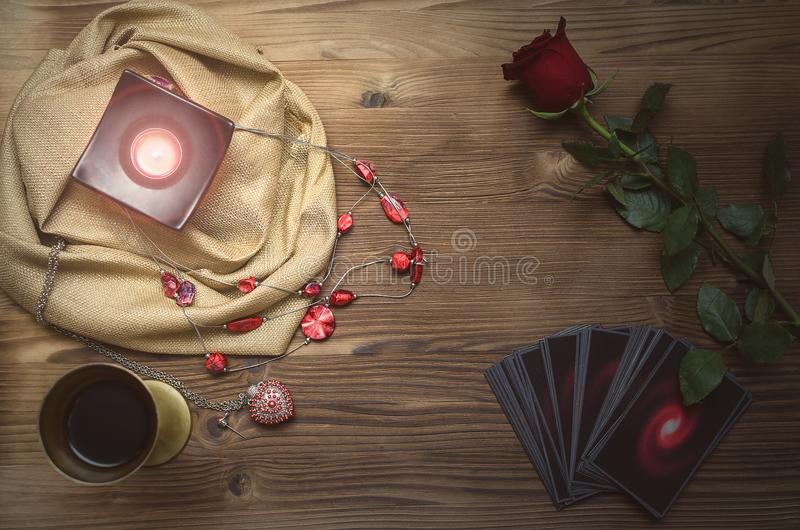 Tarot cards. Future reading. Fortune teller desk table. Romantic divination. Tarot cards deck on fortune teller table background with copy space. Future reading stock photography