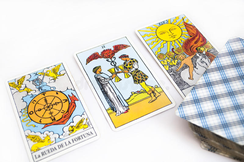 Tarot cards. Divination and prediction three Tarot cards the best choice, love, money and luck on a white background royalty free stock image
