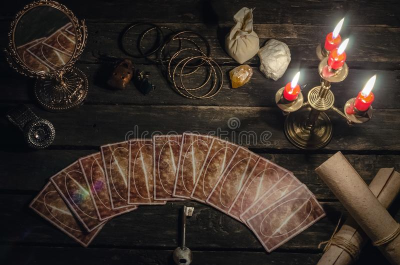 Tarot cards. Tarot cards on fortune teller desk table background. Futune reading concept. Magic mirror and key to the fate stock images