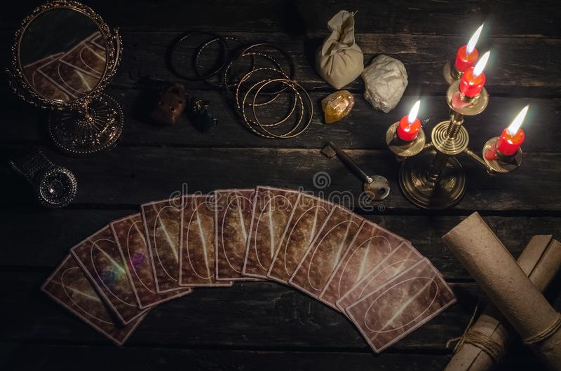 Tarot cards. Tarot cards on fortune teller desk table background. Futune reading concept. Magic mirror and key to the fate stock photo