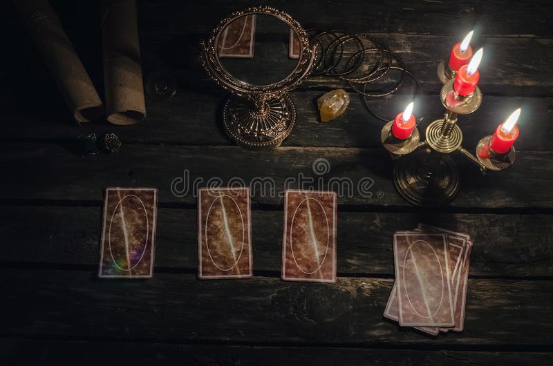 Tarot cards. Tarot cards on fortune teller desk table background. Futune reading concept. Magic mirror on paranormal table royalty free stock photography
