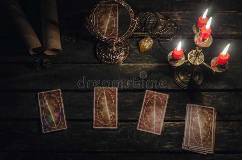 Tarot cards. Tarot cards on fortune teller desk table background. Futune reading concept. Magic mirror on paranormal table royalty free stock photo