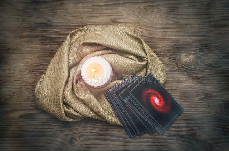 Tarot cards. Fortune teller. Divination. Tarot cards deck on fortune teller desk table background. Future reading concept royalty free stock photography