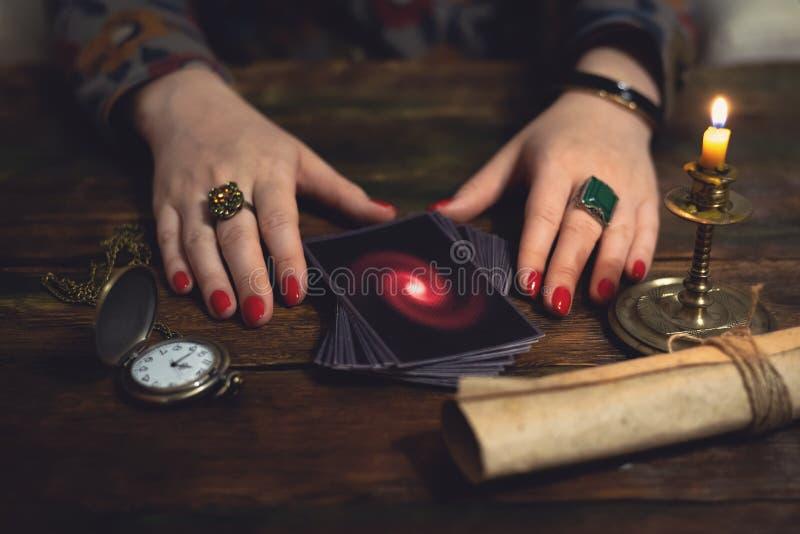 Tarot cards. Future reading concept. Tarot cards and a woman fortune teller. Future reading concept. Divination royalty free stock images