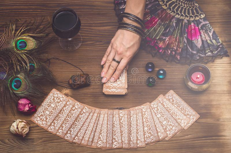 Tarot cards. Future reading. Fortune teller concept. Fortune teller female hand and tarot cards on wooden table. Fortune teller divination stock photography