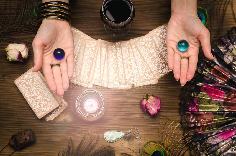 Tarot cards. Future reading. Fortune teller concept. Fortune teller female hands and tarot cards on wooden table. Divination concept royalty free stock image