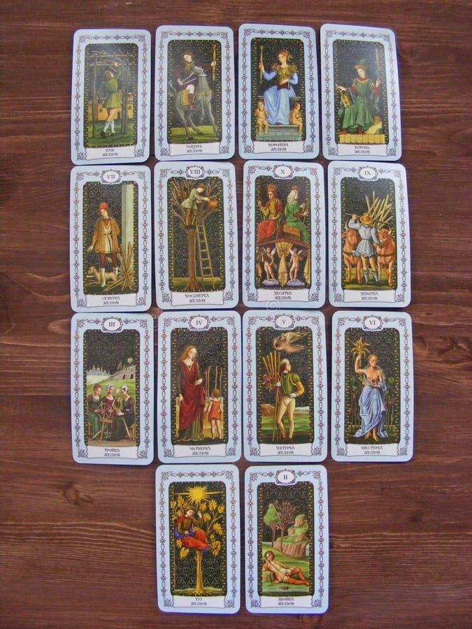 Tarot cards medieval close up, The Wands of Tarot Decks on wooden background. Tarot cards medieval close up, The Wands of Tarot Decks stock photography