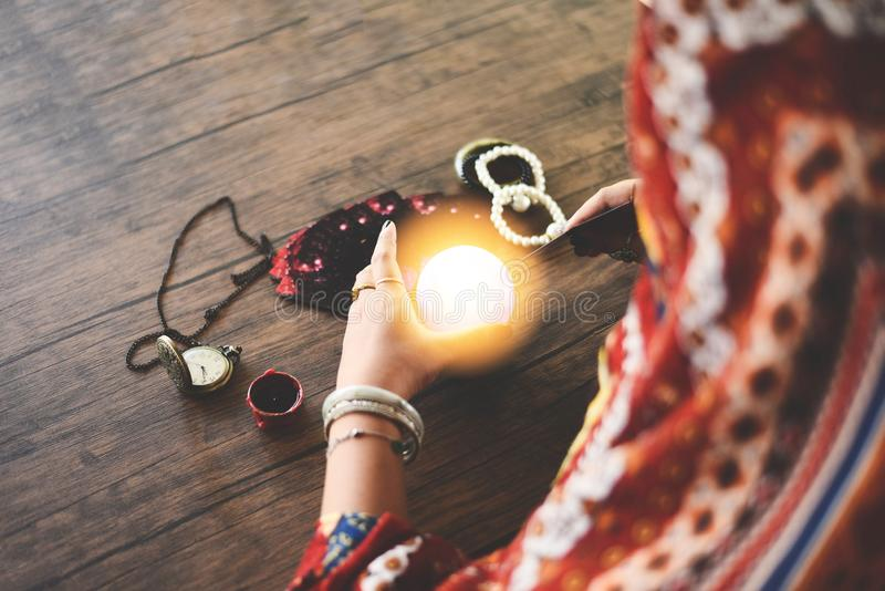 Tarot cards reading divination Psychic readings and clairvoyance concept - Crystal ball fortune teller hands. Tarot cards reading divination Psychic readings and royalty free stock image
