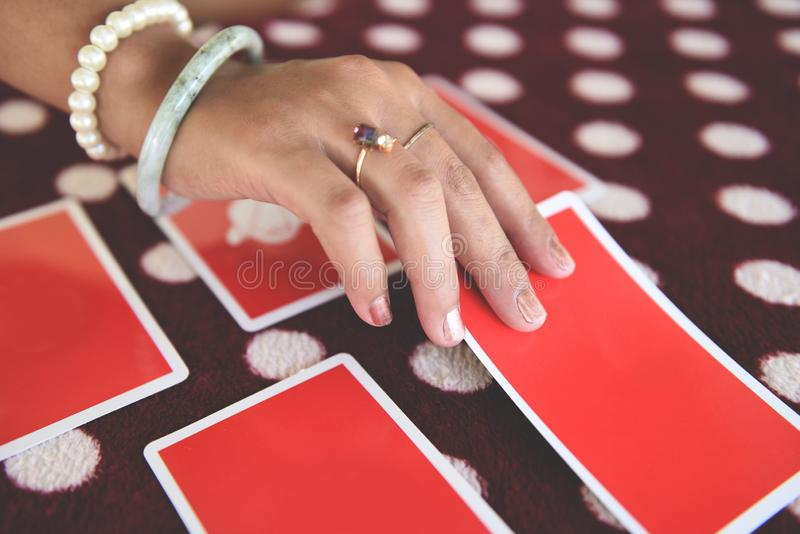 Tarot cards reading divination - Psychic readings and clairvoyance fortune teller hands concept. Tarot cards reading divination / Psychic readings and royalty free stock photos