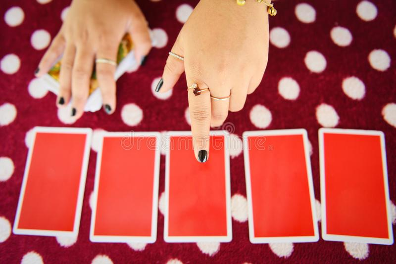Tarot cards reading divination - Psychic readings and clairvoyance fortune teller hands concept. Tarot cards reading divination / Psychic readings and royalty free stock photo