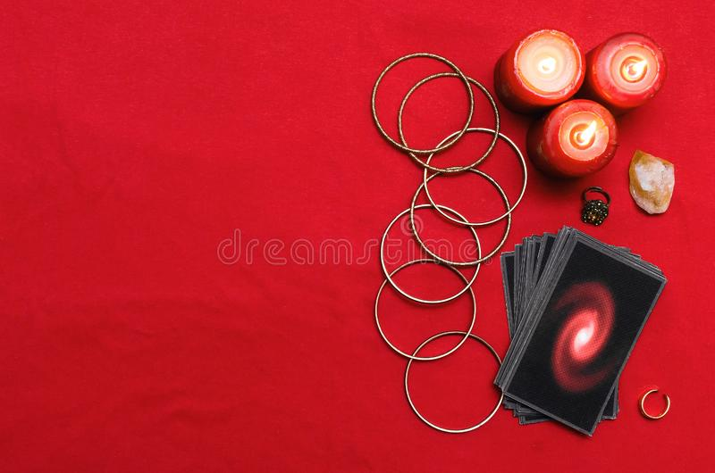 Tarot cards. Tarot cards on the red table cloth on fortune teller table background. Futune reading concept stock photo