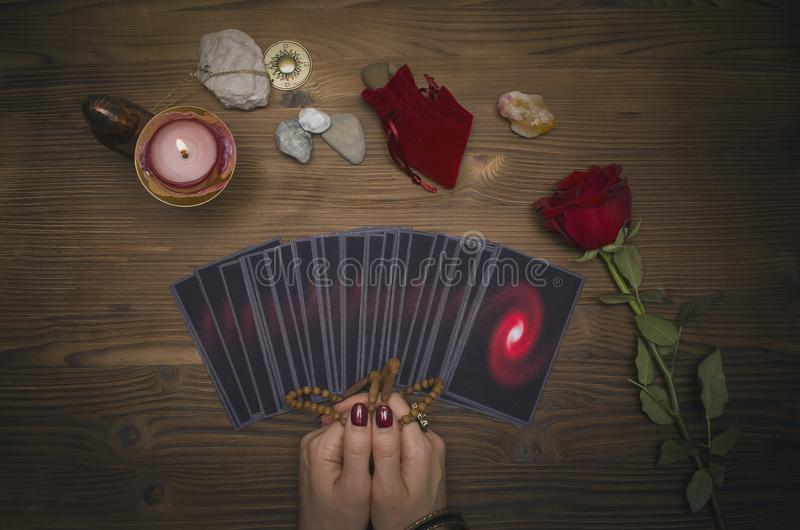 Tarot cards on the table. Fortune teller reading the future. The Psychic. Tarot cards on the table. Fortune teller reading the future and holds in hands a royalty free stock images