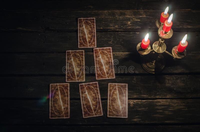 Tarot cards. Tarot cards on fortune teller desk table background. Futune reading concept stock photos