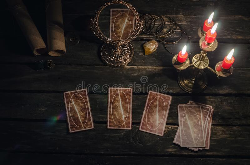 Tarot cards. Tarot cards on fortune teller desk table background. Futune reading concept. Magic mirror on paranormal table royalty free stock images