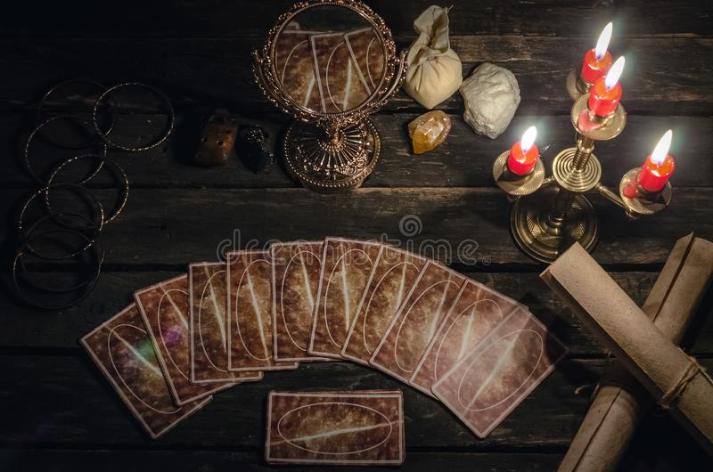 Tarot cards. Tarot cards on fortune teller desk table background. Futune reading concept. Magic mirror on paranormal table royalty free stock image