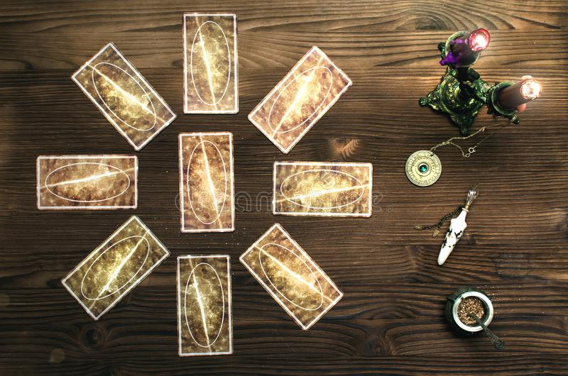 Tarot cards. Tarot cards on wooden table. Fortune teller table royalty free stock photography
