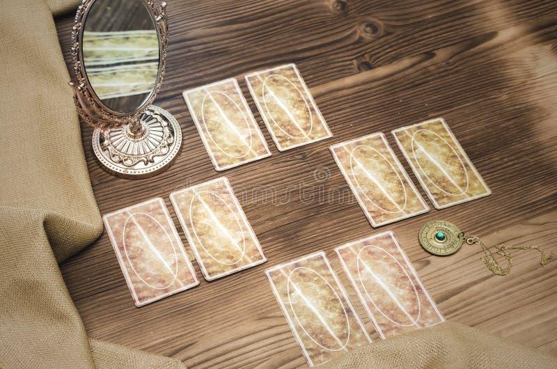 Tarot cards. Fortune-teller. Tarot cards on wooden table. Fortune teller. Future reading concept. Foreteller royalty free stock image