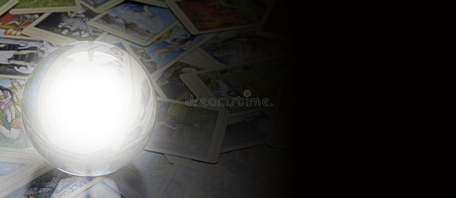 Tarot Reader's website banner. Crystal Ball with white empty center laid on scattered tarot cards faded off to the right merged with black for a wide web banner
