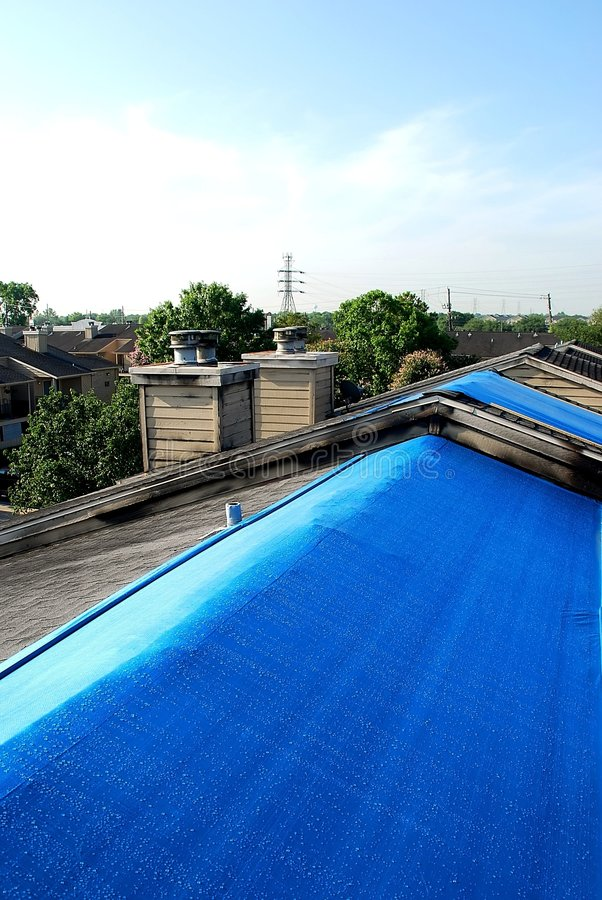 Download Tarpaulins on roofs stock image. Image of cover, building - 5841643