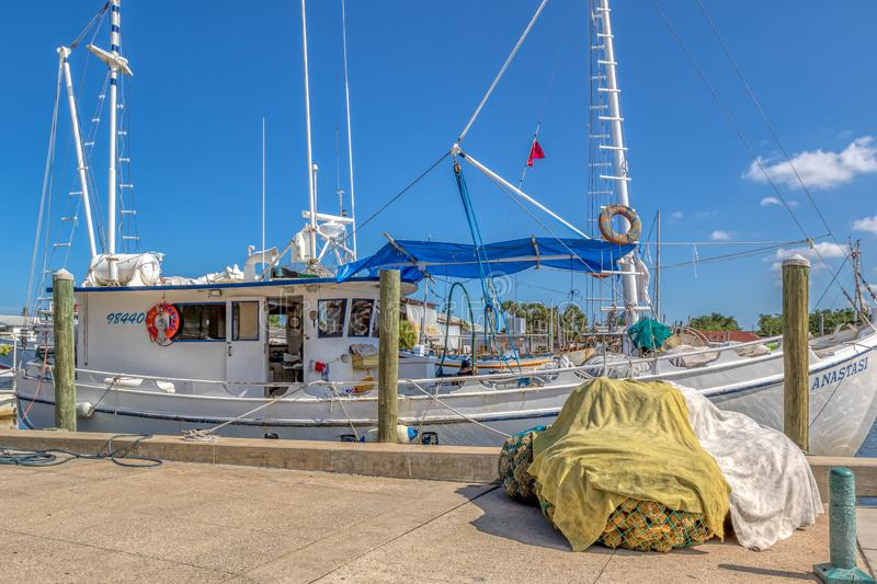 TARPON SPRINGS, FLORIDA - JUNE 30, 2019: Net full of sponges by a boat on the sponge docks royalty free stock photography
