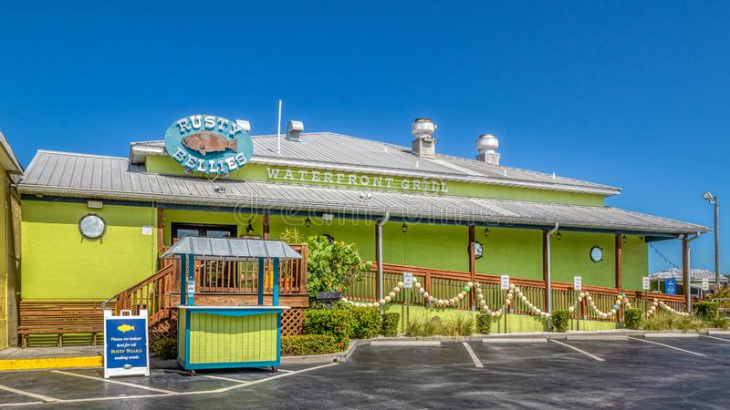 TARPON SPRINGS, FLORIDA - JUNE 30, 2019: Rusty Bellies bright green waterfront grill seafood restaurant royalty free stock photos