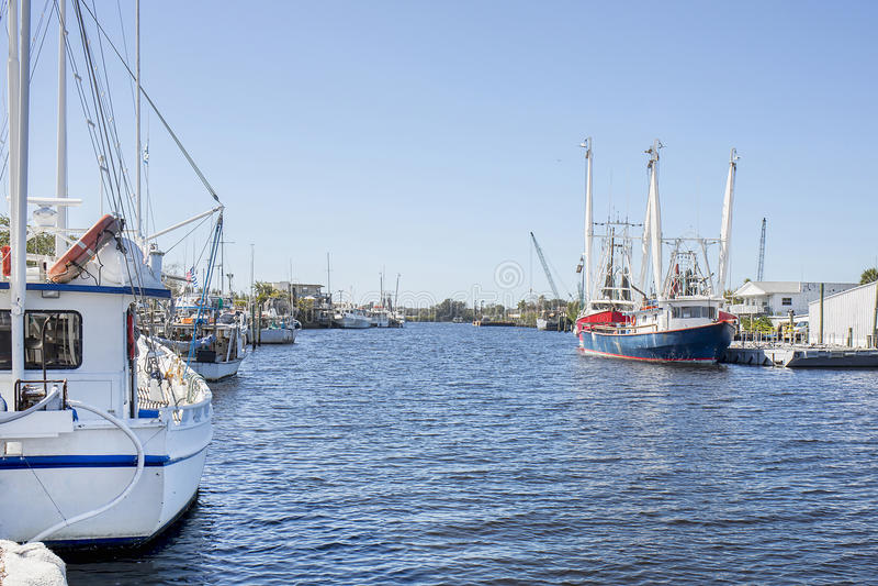 Tarpon Springs Sponge Docks. Commercial fishing vessels docked along a canal at Tarpon Springs Sponge Docks stock image