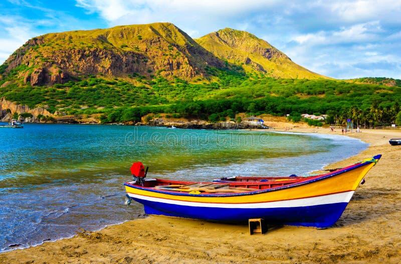 Cape Verde - Tarrafal Cove Yellow Sand Beach, Colorful Fishing Boat. Tarrafal beautiful cove beach. Cape Verde is an african tropical archipelago where people stock image