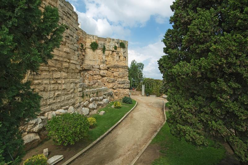 Tarragona Passeig arqueologic under Roman era walls. Tarragona Passeig arqueologic Archaeological Promenade under Roman era walls stock images