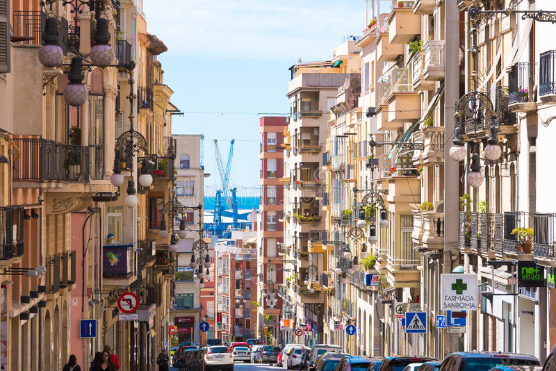 TARRAGONA, SPAIN - MAY 1, 2017: City landscape. City street leading to the waterfront. Urban perspective. TARRAGONA, SPAIN - MAY 1, 2017: City landscape. City stock photos