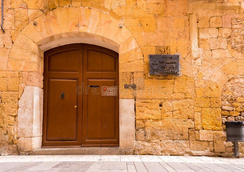 TARRAGONA, SPAIN - MAY 1, 2017: The door of Colla de Castellers Xiquets de Tarragona. Copy space for text. TARRAGONA, SPAIN - MAY 1, 2017: The door of Colla de stock images