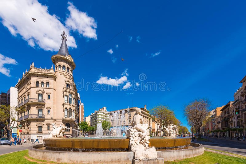 TARRAGONA, SPAIN - MAY 1, 2017: Fountain decorated with sculptures depicting four continents. The Century`s Fountain. Chamber of Commerce of Tarragona. Copy stock image