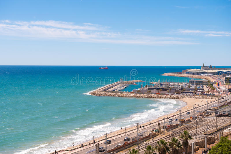 TARRAGONA, SPAIN - MAY 1, 2017: Port and railway station in Tarragona, Catalunya, Spain. Copy space for text. TARRAGONA, SPAIN - MAY 1, 2017: Port and railway stock images