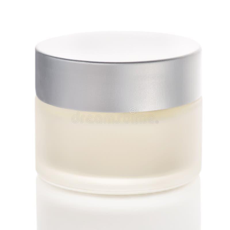 Tarro de botellas del cosmético de la crema, de la mano de la maqueta, del facial o de la crema corporal foto de archivo libre de regalías