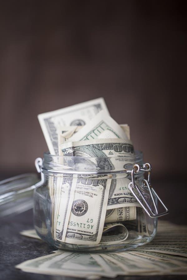 Tarro de cristal con dólar foto de archivo libre de regalías