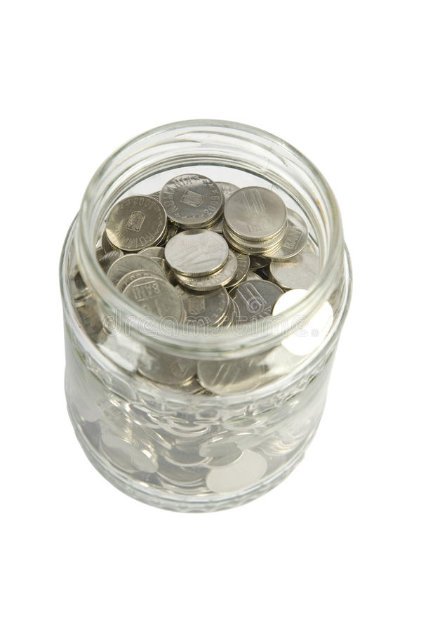Tarro de cristal con las monedas de plata fotos de archivo libres de regalías