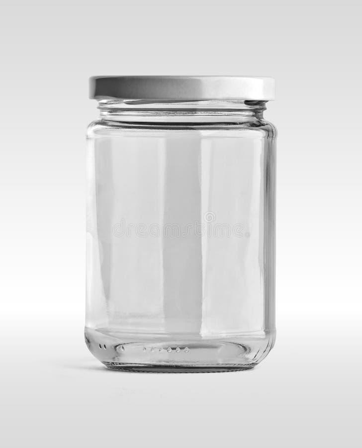 Tarro de cristal vacío y casquillo blanco en vista delantera aislados en el fondo blanco imagen de archivo libre de regalías