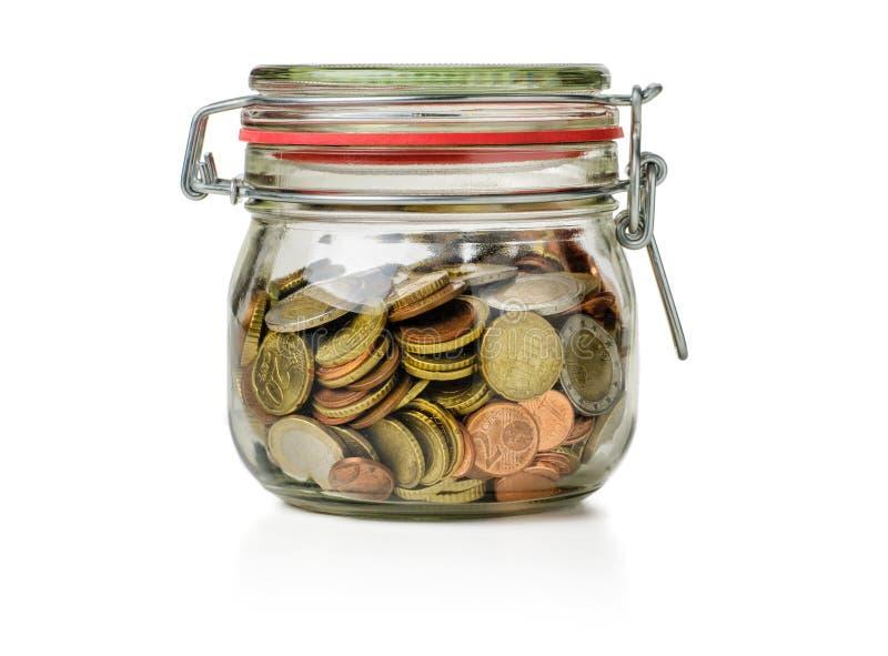 Tarro de enlatado con las monedas imagenes de archivo